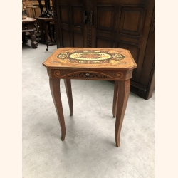 Petite antique French side table with a surprise