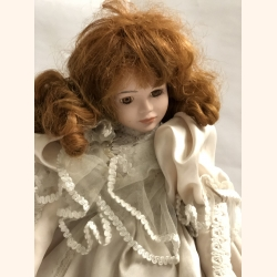 Vintage porcelain doll in perfect condition