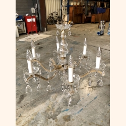 Beautiful glass chandelier fully decorated with crystals
