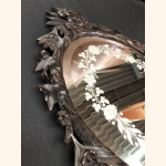 Mesmerizing antique mirror with hand carved wooden bezel