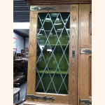 Identical stained glass vitrines with hand-carved details