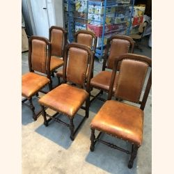 Stunning set of 6 chairs with premium quality leather. Impeccable condition.